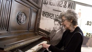 Daughter of Irving Berlin playing his piano at the Red Star Line Museum