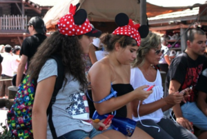 Guests on cell phones at MK